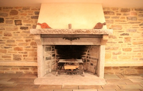 Custom stone fireplace and surround in basement